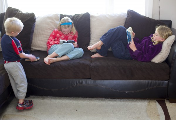 From left, Evan, 5, Megan, 8, and Erin, 11, read at their home in Orono on Tuesday. They are home-schooled by their mother, Aimee Gerbi.