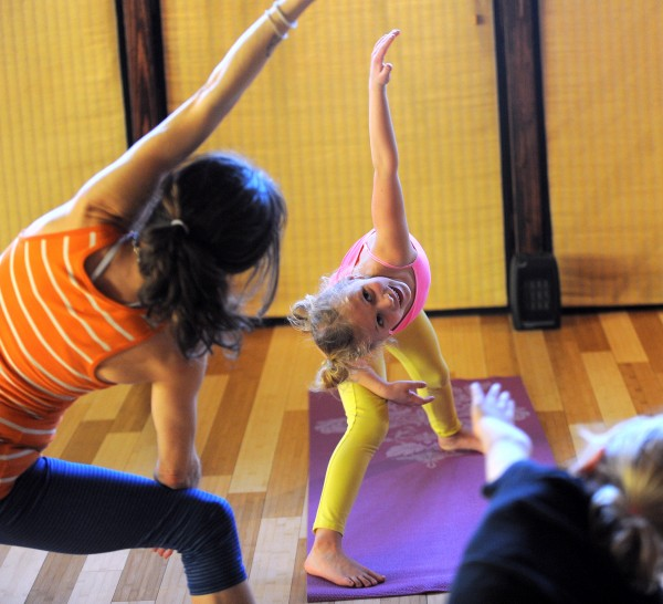 Zoe Higgins, 6, (center) of Hampden has been coming to Kids' Mantis Yoga class with her mother Katie Higgins and and four-year-old sister Ella at the OmLand Yoga studio in Orono.