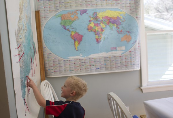 Evan Gerbi, 5, points our places on a map of Maine at his home in Orono on Tuesday.