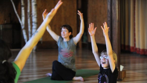 Emily Feher, 8, (right) of Orono came to the Kids's Matis Yoga calss with her mother Sandy Feher (center) at the OmLand Yoga studio in Orono.