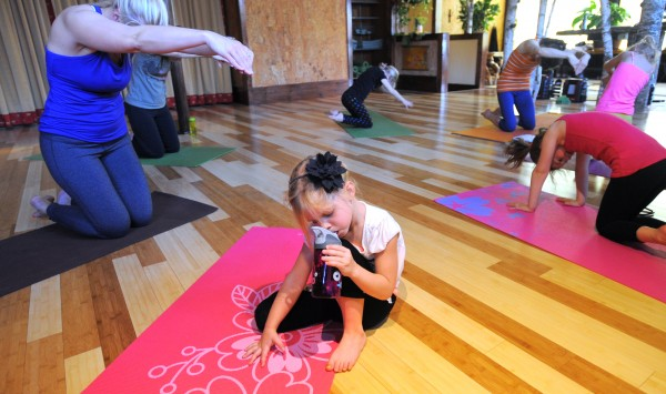 Four-year-old Ella Higgins takes a water break during Kids' Mantis Yoga class taught by Holly Twining at the OmLand Yoga studio in Orono.