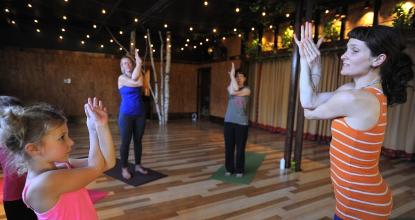 Kids' Mantis Yoga class taught by Holly Twining (right) at the OmLand Yoga studio in Orono.
