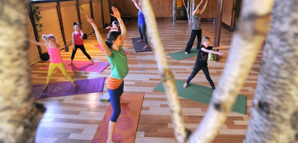 Kids' Mantis Yoga class taught by Holly Twining at the OmLand Yoga studio in Orono.
