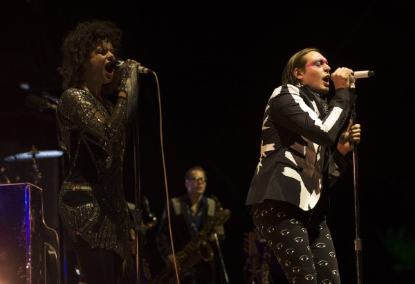 Lead vocalist Win Butler (R) and his wife Regine Chassagne of rock band Arcade Fire perform at the Coachella Valley Music and Arts Festival in Indio, California April 13, 2014.