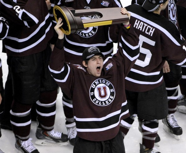 Union forward Kevin Sullivan (16) holds the NCAA championship trophy after defeating Minnesota 7-4 in the Frozen Four final at Wells Fargo Center in Philadelphia Saturday night.