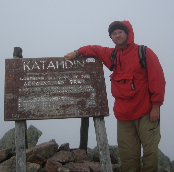 Kerry Gallivan of Yarmouth, co-founder of the outdoor app company Chimani with Shaun Meredith of Harpswell, stands at the summit of Katahdin, Maine's highest peak, which is featured in Chimani's Baxter State Park app that launched in 2014.