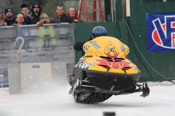 Mike Moulton of China, Maine, accelerates on the Medway ice dragway on Jan. 18 during the qualifying races for the Northeast Winter Nationals Snowmobile Ice Drag Races.