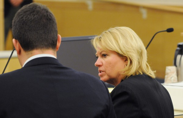Assistant Attorney General Lisa Marchese talks with law extern Robert Connolly at the Penobscot Judicial Center in Bangor on Wednesday, March 12, during a hearing to determine if Nicholas Sexton and Randall Daluz should have a trial separate from each other.
