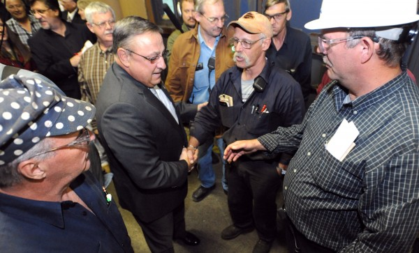 Gov. Paul LePage (second from left) shakes hands with employees at Great Northern Paper company in East-Millinocket after a press conference in this October 2011 file photo.