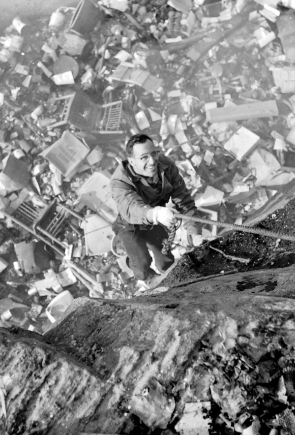 Albert Worden, an employee of the Heart of Maine Exterminating Company of Dexter, turned mountain climber to descend into the Rockland city dump to spread rat poison among the rubble and trash in this July 2010 file photo.
