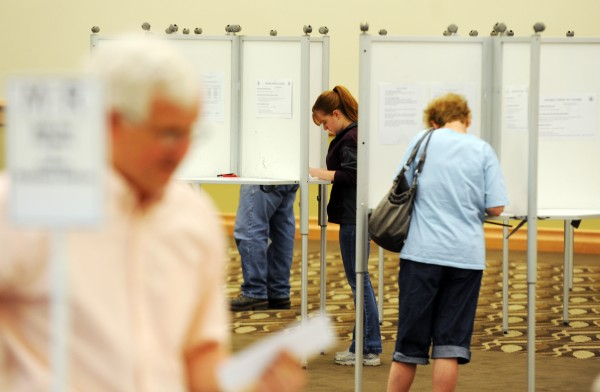 Voters mark their ballots at the Cross Insurance Center on Tuesday, June 18, 2013.