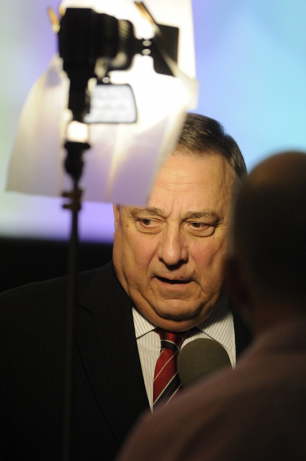 Governor Paul LePage gives an interview with a Canadian TV station prior to offering opening remarks at the Maine Tourism Conference at the Cross Insurance Center in Bangor on Wednesday, March 19.