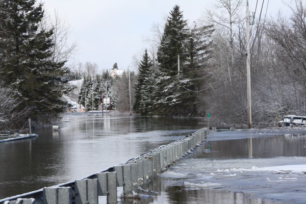 Route 164, also known as the Washburn Road, flooded Wednesday near Crouseville after the Aroostook River crested its banks.