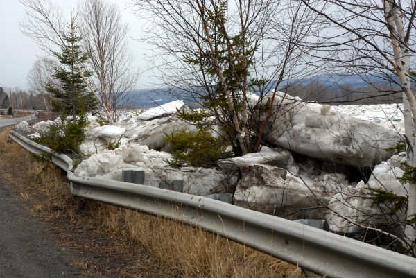 Large chunks of ice left over from an ice jam on the St. John River about eight miles west of Fort Kent push against a guardrail along Route 161 which had been closed for a period of time last week due to the rising waters.