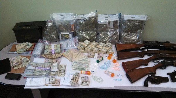 A large quantity of cash, drugs and firearms were seized in a drug bust in Franklin County on Friday.