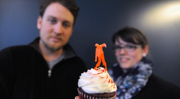 John Carney and his wife, Christine, co-owners of Thick & Thin Designs with the cupcake topper that started it all.