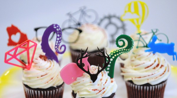 Cupcake toppers made by Thick & Thin Designs.