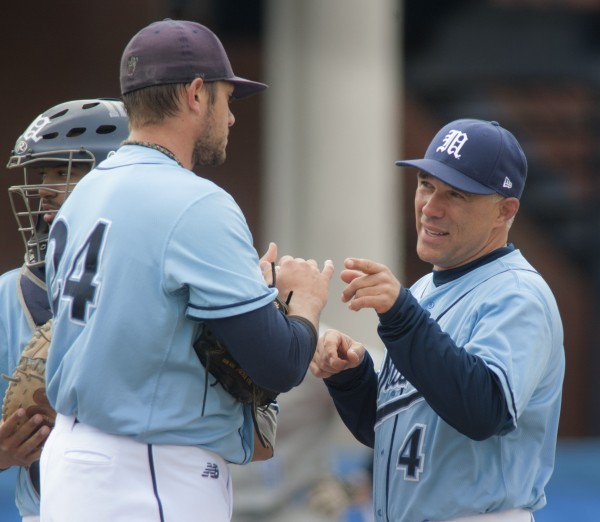 Maine coach Steve Trimper (right) has a conference on the mound with starting pitcher Luke Morrill (left) in the game against the New York Institute of Technology on Sunday in Orono.
