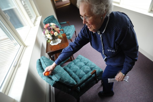 Jackie Tardiff, a resident at the Ellen M. Leach Memorial Home, grabs a plastic Easter egg from the back of a chair during the second annual Easter Egg Hunt at the retirement home in Brewer on Tuesday.