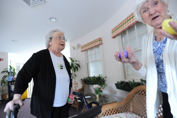 Mary Wardwell (left) and Dottie Russell, both residents at the Ellen M. Leach Memorial Home, react to finding plastic Easter eggs on the second floor during the second annual Easter Egg Hunt at the retirement home in Brewer on Tuesday.
