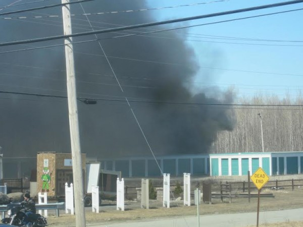 Smoke billows over a storage unit on Hildreth Street in Bangor on Easter. A sport utility vehicle caught fire while it was being repaired, according to the Bangor Fire Department.