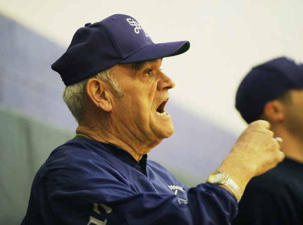 Long-time baseball coach Murray W. Putnam shouts out drills to his players during an early morning practice at Southern Aroostook High School on Tuesday, March 25, 2008.