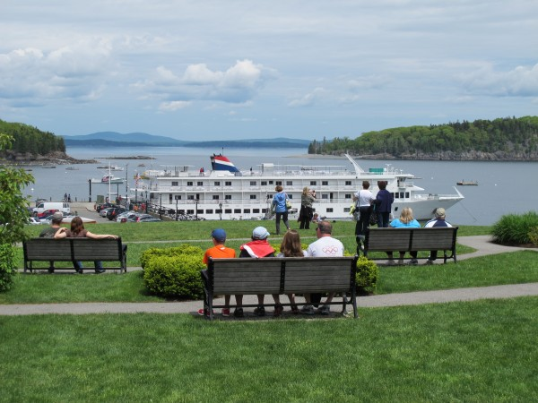 Memorial Day visitors soak up some sunshine on the grassy park overlooking the Bar Harbor waterfront in this May 28, 2012 photo.