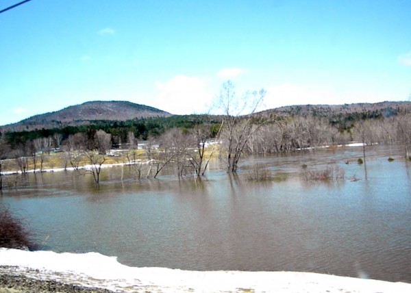 The Androscoggin River had exceeded its banks Monday and continued to rise as of 1 p.m. in the western Maine town of Rumford.