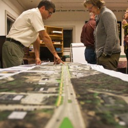 Falmouth Town Councilor Claudia King, right, looks at designs for the Route One Infrastructure Plan in this photo from a public meeting at Falmouth Memorial Library in October 2013. The $12.3 million project is set to begin early next month.