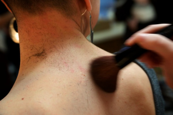 Hair is brushed away from a student actor's neck on USM's Gorham campus on Saturday morning as cast members of &quotIn the Underworld&quot prepare for their roles as Nazi concentration camp prisoners by shaving their heads.
