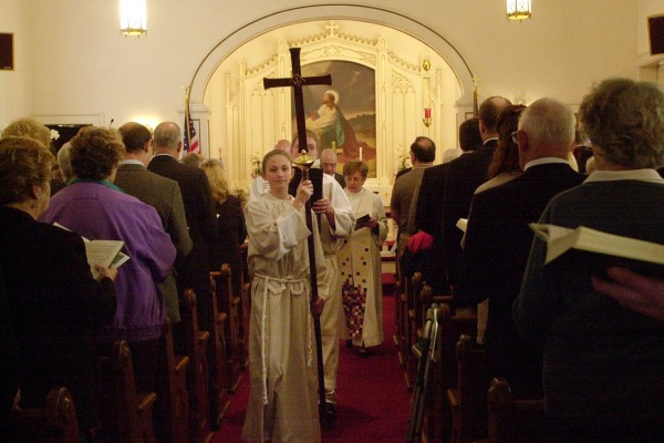 Stephanie Plourde leads the procession out following the service at Gustaf Adolph Lutheran Church in New Sweden Maine on Sunday, May 4, 2003. The procession was a symbolic way for the congregation to reclaim their church following the arsenic poisonings at the church that rocked the community.