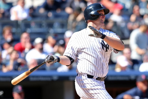 New York Yankees catcher Brian McCann (34) hits a two-run home run against the Boston Red Sox during the sixth inning of a game at Yankee Stadium in New York  Saturday.