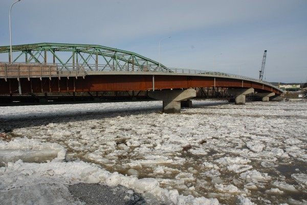 Officials had worried the five columns offset from each other on the old and new international bridges in Fort Kent could create an jam when ice ran on the St. John River this year. As of Friday morning, massive quantities of ice had flowed through with no issues.
