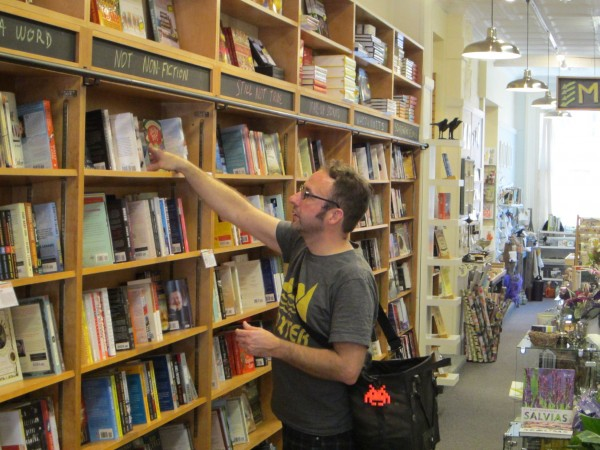 Mike Popovic, who rode his bicycle to Portland from Westbrook, browses in the new Sherman's Books and Stationery store on Exchange Street in Portland.