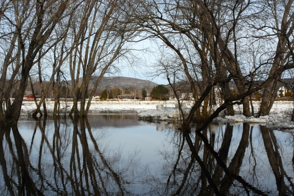 Water creeps up onto the boat landing area of River Side Park in Fort Kent as ice continues to flow down the St. John River Friday morning.