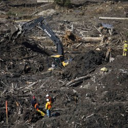 Victims of US mudslide are remembered in first funeral services
