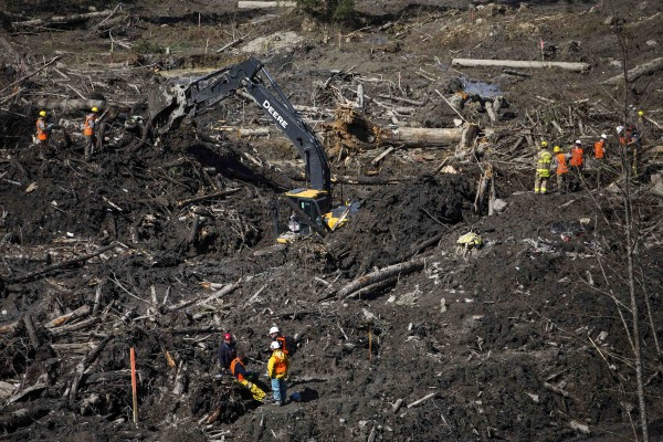 Rescue workers search for victims in Oso, Wash., on Tuesday.