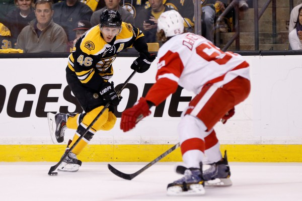 Boston Bruins center David Krejci (46) controls the puck while defended by Detroit Red Wings defenseman Danny DeKeyser (65) during the first period in game two of the first round of the 2014 Stanley Cup Playoffs at TD Banknorth Garden on Sunday.