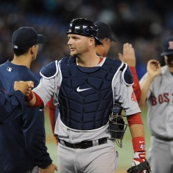 Lester, Carp help Red Sox clinch AL East title