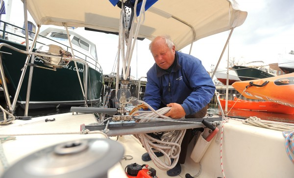 Frederick &quotButch&quot Minson, 68 of Verona Island organizes gear on his boat after just completing a voyage to Florida and back on his Lindenberg 28 sailboat the Cats Paw.  Minson is a life-long sailer with sailboat racer and instructor.  He left Maine in October and sailed solo to Florida where his wife Janice Minson joined him to cruise the Florida coast and celebrate their 30th wedding anniversary.