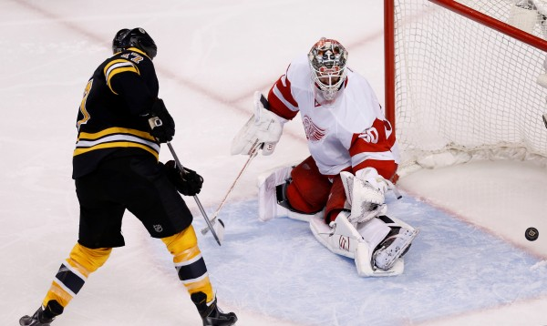 Boston Bruins left wing Milan Lucic scores a goal against Detroit Red Wings goalie Jonas Gustavsson during the third period in game five of the first round of the Stanley Cup Playoffs at TD Banknorth Garden in Boston Saturday.