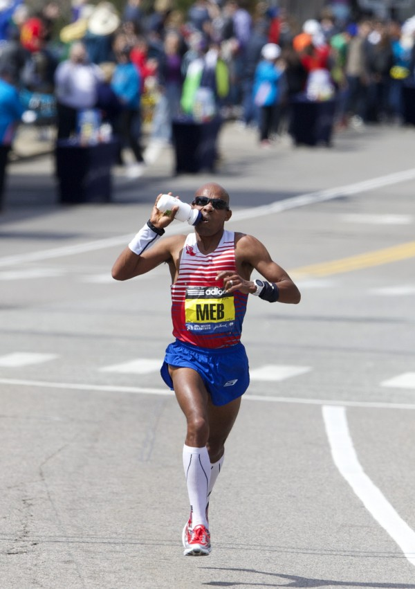 Meb Keflezighi takes a drink from a bottle during the 2014 Boston Marathon.
