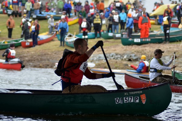 Waves of racers leave the shores of Kenduskeag and pass under a bridge at the start of the Kenduskeag Stream Canoe Race on Saturday. About 800 racers in more than 400 boats participated.