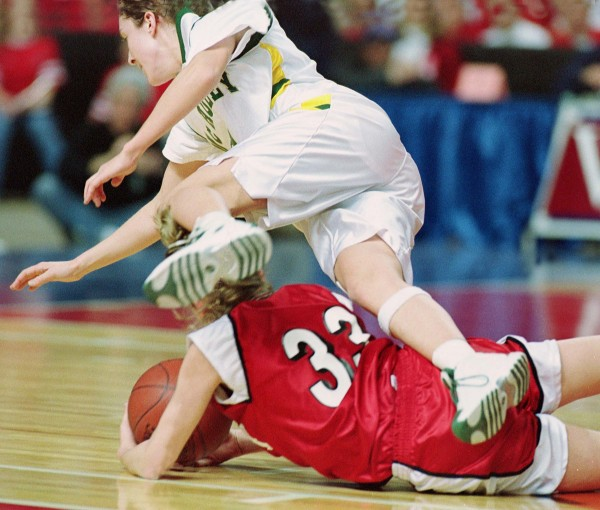 In this March 2002 file photo, McAuley's Sarah Marshall (top) collides with Cony's Karen Sirois in the first half of the Class A state final at the Cumberland County Civic Center in Portland.