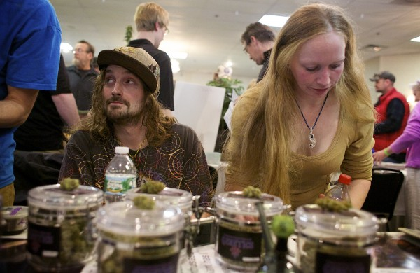 Mark Megill (left) and Rose Megill of Vacationland Genetics exhibit their products at the Home Grown Maine Medical Marijuana Trade Show at the Spectacular Event Center in Bangor on Saturday.
