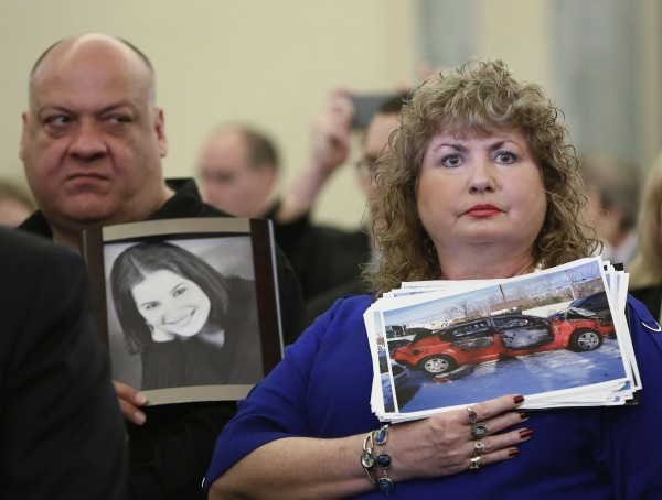 Mary Theresa Ruddy (R), whose daughter Kelly was killed in 2010 when she lost control of her 2005 Chevrolet Cobalt, holds a picture of the vehicle, while her husband Leo (L) holds a photo of their daughter at the Senate Commerce and Transportation Consumer Protection, Product Safety and Insurance subcommittee in Washington on April 2, 2014.