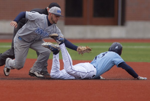 New York Institute of Technology infielder Anthony Martelli (9) makes the tag on a sliding Jake Osborne (13) for the out after Osborne was caught off first in the fifth inning of their game at Mahaney Diamond in Orono on Sunday.