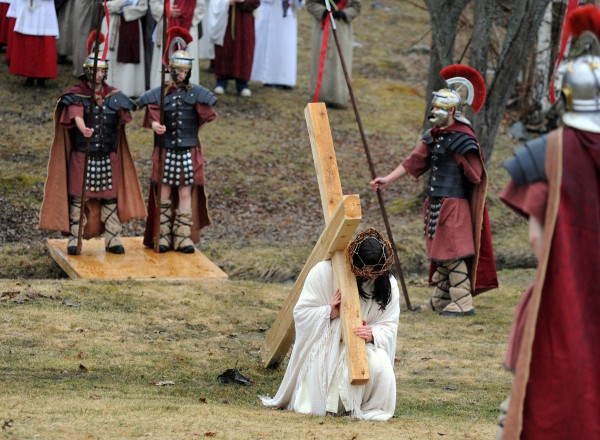 Jesus falls for the first time during the third station of the third annual Way of the Cross Palm Sunday Community Procession. About 80 parishioners from St. Paul the Apostle Parish took part in the pilgrimage of prayer in preparation for Easter. The procession began at St. Joseph Catholic Church in Brewer and ended at St. John Catholic Church in Bangor. Jesus was portrayed by 17-year-old Hampden Academy senior Jake Maltz.