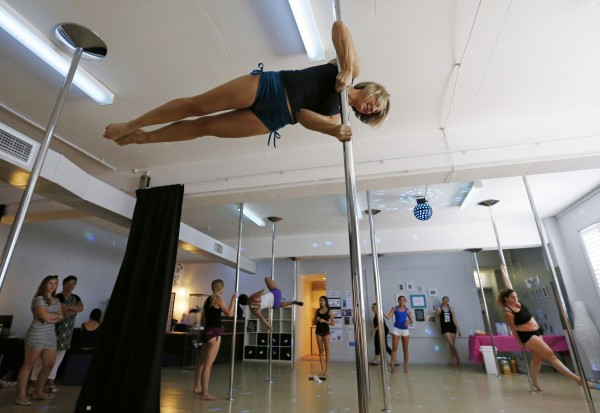 In this March 2014 file photo, Instructor Peta Howlett practices her moves during an International Women's Day event at a women's-only pole dancing fitness studio called Studio Exclusive.