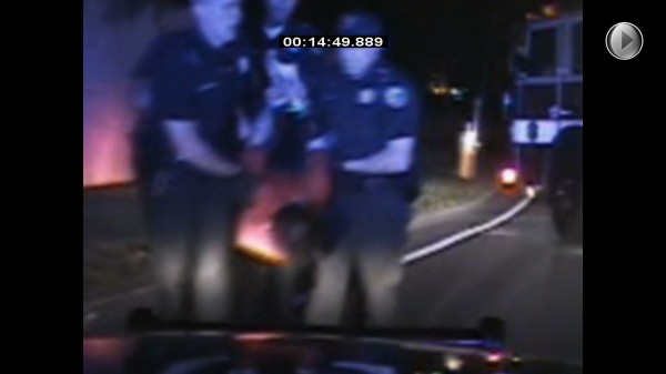 A still frame from a patrol officer's camera shows Bangor Police carrying Phillip A. McCue to a patrol car on Sept. 12, 2012 after using a Taser to subdue him during an arrest. McCue later died at Eastern Maine Medical Center in Bangor.
